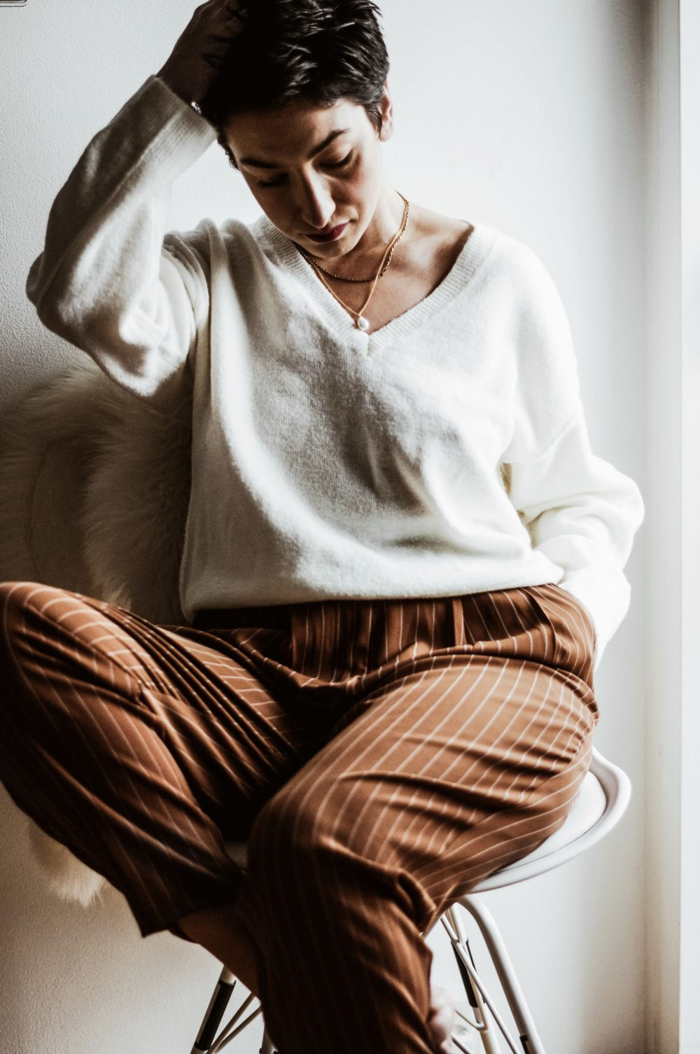 The-Scandinavian-Guide-to-Happiness-at-Work-Improve-your-work-life-balance-with-these-Scandinavian-habits-casual-outfit-sweater-suit-pants-spring-outfit